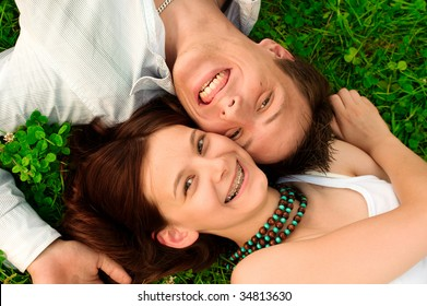 young couple flirting in the park