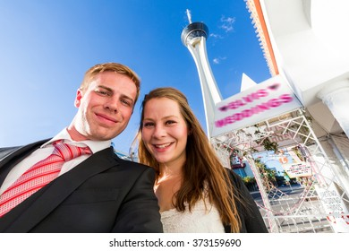 A young couple in front of a wedding chapel in Las Vegas