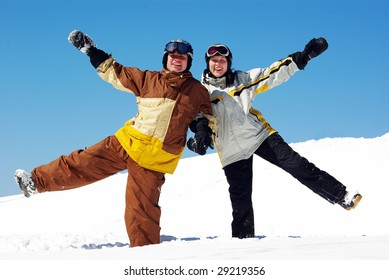Young couple funning in the ski resort