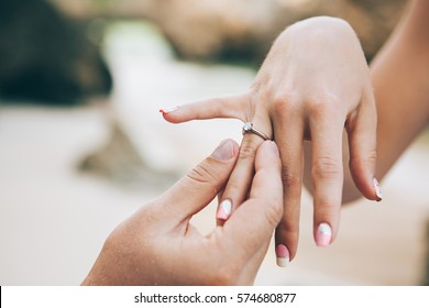 Young couple is getting engaged, man propose woman, new family celebration, engagement ring, jewellery