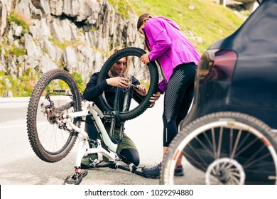 Young Couple Getting Their Bikes Ready