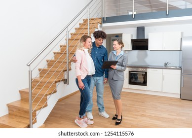 Young couple getting tour through apartment they consider renting