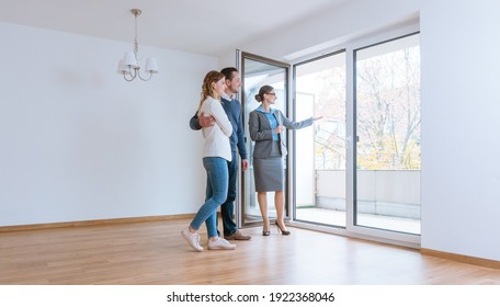 Young couple getting tour through apartment they consider renting or purchasing