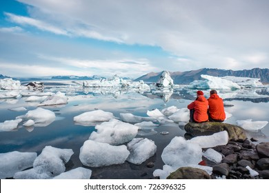 A young couple in glacier lagoon in Iceland.