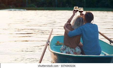 Young couple with glasses of wine outdoors