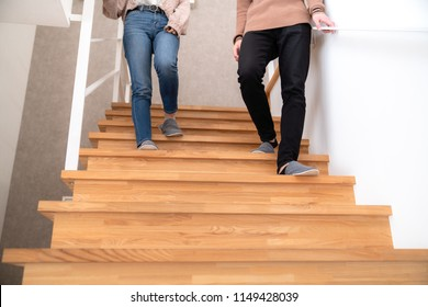 Young couple going down stairs.