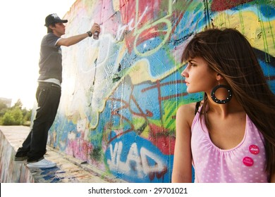 Young couple in a graffiti background