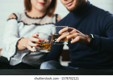 Young couple guy and girl drink whiskey on a date very romantic