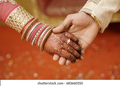 Young Couple Hand in hand in Engagement ring ceremony