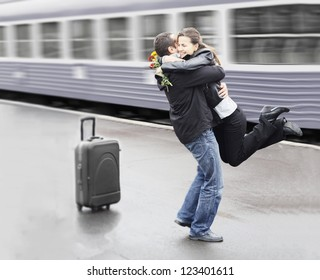 Young couple happy to meet again in the train station
