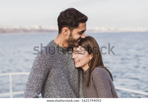Young couple have good time on cruise ship. Portrait of beautiful young couple laughing