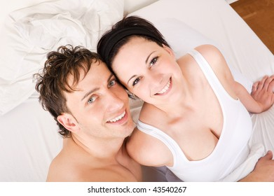 Young couple  have some fun in the bed