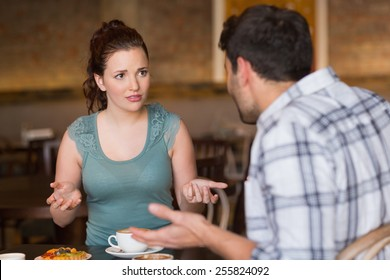 Young couple having an argument at the cafe