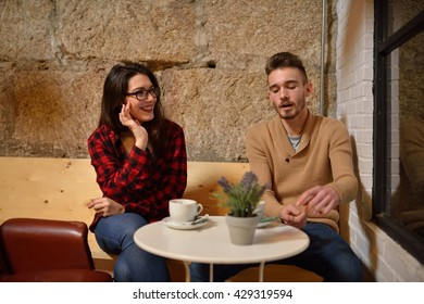 Young couple having coffee