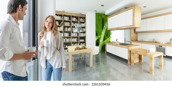 Young couple having coffee in a modern upscale house interior 3D rendering