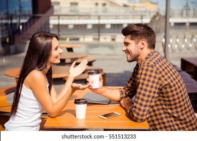 Young couple having date in cafe, drinking coffee  and talking