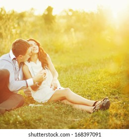 Young couple having date. Spending great time together in field.