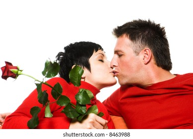 Young couple is having a date. They are kissing each other.