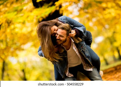 Young couple having fun in the autumn park