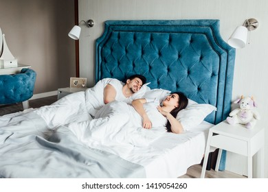 Young couple having fun in bed at home in bedroom. Morning, together..