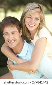 Young Couple Having Fun In Countryside Together