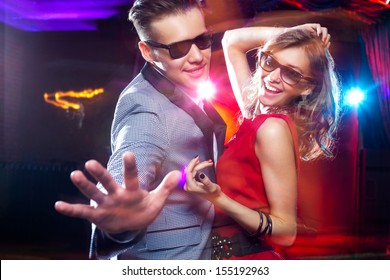 young couple having fun dancing at  party.