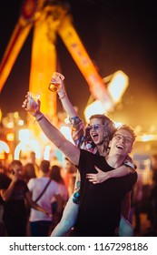 Young couple having fun on music festival