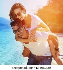 Young couple having fun on a tropical beach