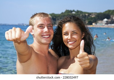Young couple having fun on the seaside.