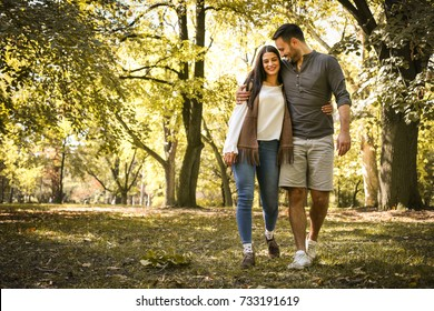 Young couple having fun in park.
