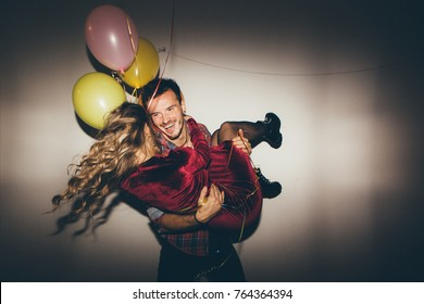 Young couple having fun at the party