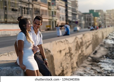 Young couple having fun together on the Malecon in Havana, Cuba.