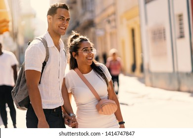 Young couple having fun together in the street. Lifestyle. Havana, Cuba.