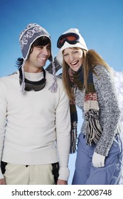 young couple having fun wearing their ski outfits
