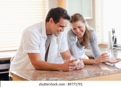 Young couple having a glass of milk in the kitchen