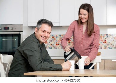 Young couple having morning coffee