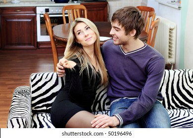 Young couple having a rest at home.