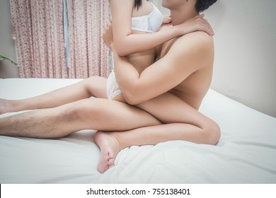 Young couple is having sex on bed.
