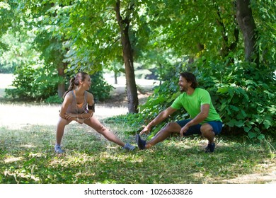 Young couple having training in the park on a sunny day