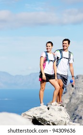 young couple hiking outdoors in the sunshine, healthy lifestyle concept