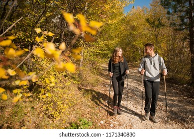 Young couple hikino on a warm autumn afternoon in nature