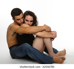 young couple holding each other with affection, isolated on white