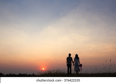 A young couple holding hands. In Nature sunrise, vintage tone