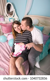 Young couple at home. Pregnant woman and her husband.