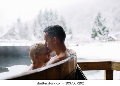 Young couple in hot spring. Couple relaxing in spa resort.