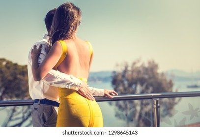 Young couple hugging outside. Summer vacation