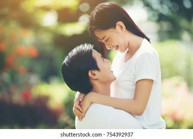 Young Couple hugging together during walking relaxing together.