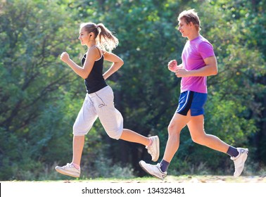 Young couple jogging on a morning park