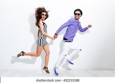 Young couple jumping isolated on a white background