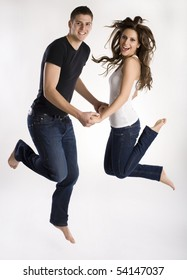 Young couple jumps in the air